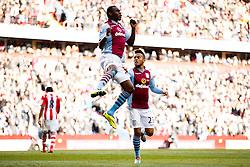 Aston Villa Forward Christian Benteke (BEL) leaps in the compete in the air as he celebrates scoring a goal - Photo mandatory by-line: Rogan Thomson/JMP - 07966 386802 - 23/03/2014 - SPORT - FOOTBALL - Villa Park, Birmingham - Aston Villa v Stoke City - Barclays Premier League.
