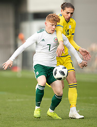 NEWPORT, WALES - Tuesday, November 19, 2019: Wales' Samuel Pearson in action against Kosovo's Gentrit Halili during the UEFA Under-19 Championship Qualifying Group between Kosovo and Wales at Rodney Parade. (Pic by Laura Malkin/Propaganda)