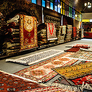 Interior of a Turkish carpet shop at the Arastar Bazaar, a small bazaar next to the Sultanahment Camii (Blue Mosque) in Istanbul, Turkey.