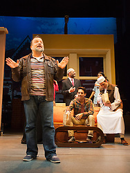 """© Licensed to London News Pictures. 08/10/2014. London, England. Pictured: Kev Orkian as Mahmoud. The Musical """"The Infidel"""", based on the same named film by David Baddiel,  premieres at the Theatre Royal Stratford East, London. Directed by David Baddiel and Kerry Michael, book and lyrics by David Baddiel with music by Erran Baron Cohen. The Infidel is a story about Muslim man Mahmoud (Kev Orkian) who discovered that he is not only adopted but also Jewish. Photo credit: Bettina Strenske/LNP"""