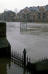 Flooded street & River Ouse York UK