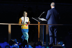 Sally Pearson runs up to The Prince of Wales with the Commonwealth Torch during the Opening Ceremony for the 2018 Commonwealth Games at the Carrara Stadium in the Gold Coast, Australia.