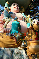 Buddha having his navel cleaned, Hung Long Tu Pagoda, Phu Quoc.