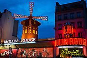 Moulin Rouge, French for Red Mill, is a cabaret in Paris, France. It was built in 1889 by Joseph Oller, who also owned the Paris Olympia. Close to Montmartre in the Paris district of Pigalle on Boulevard de Clichy in the 18th arrondissement, it is marked by the red windmill on its roof. The closest métro station is Blanche.<br /> Moulin Rouge is best known as the spiritual birthplace of the modern form of the can-can dance. Originally introduced as a seductive dance by the courtesans who operated from the site, the can-can dance revue evolved into a form of entertainment of its own and led to the introduction of cabarets across Europe. Today, Moulin Rouge is a tourist attraction, offering musical dance entertainment for visitors from around the world. The club's decor still contains much of the romance of turn-of-the-20th-century France.