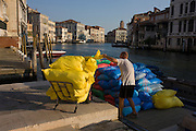Sacks of supplies being unloaded from a boat on the Grand Canal, Venice.