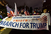 """Several hundred people, waving flags and banners, or dressed as Donald Trump, take part in a """"March For Trump"""" rally  in support of the out-going United States President, Donald Trump. Tokyo, Japan. Wednesday January 6th 2021. The rally of mostly Japanese people took place as part of a similar rally by Trump-supporters in Washington DC as the results of the 2020 US Presidential election were confirmed."""