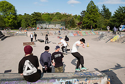 Skateboarders at skatepark in Kelvingrove Park in Glasgow, Scotland, United Kingdom