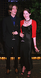MR JESSE WOOD son of Ronnie Wood of the Rolling Stones and MISS JASMINE GUINNESS, at a reception in London on 6th June 1998.MIB 174