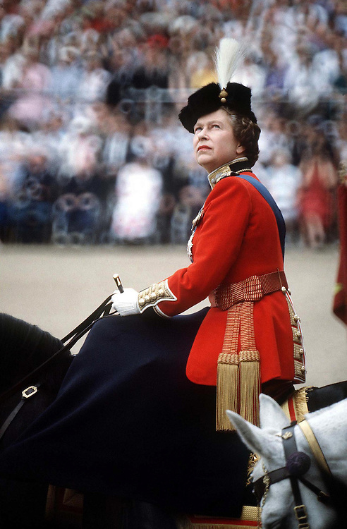 The Queen rides side-saddle on her horse 'Burma' at the Trooping of the Colour, London,UK in June 1984. Photograph by Jayne Fincher