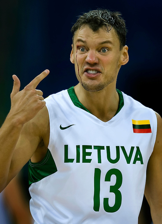 Sarunas Jasikevicius of Lithuania protested to the referee about no foul called on a play in the first period where his face was cut open on a shot attempt during the bronze medal match between Argentina and Lithuania on August 24, 2008 at the 2008 Summer Olympic Games in Beijing, China. (Photo by David Eulitt/The Kansas City Star/MCT).