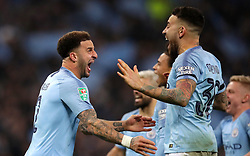 Manchester City's Kyle Walker (left) celebrates with team mates after winning the Carabao Cup Final in the penalty shoot out
