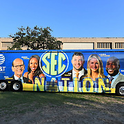 Travis' portraits of SEC Network talent are seen on the ESPN bus parked outside the Texas A&M stadium. ©Travis Bell Photography