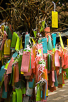 Omikuji or paper wishes, are a method used for divining personal fortunes which involves drawing straws from a cylinder and then receiving a printed fortune or poem corresponding to a cypher printed on the stick. This is the type of omikuji found most commonly today at shrines.