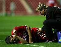 Photo: Andrew Unwin.<br />Middlesbrough v Dnipro. UEFA Cup. 03/11/2005.<br />Middlesbrough's Stuart Parnaby (L) appears to be in agony as he receives treatment.