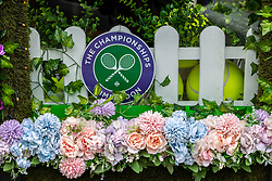 Licensed to London News Pictures. 24/06/2021. London, UK. Wimbledon Village decorations start to go up in SW19 for the first time in two years as the Tennis Championships is set to kicks off this Monday on the 28 June 2021. The AELTC Championships at Wimbledon, southwest London is back on Monday after it was cancelled last year due to the Covid-19 pandemic. Capacity is down by 50% and fans must preordered tickets with no overnight queuing. Photo credit: Alex Lentati/LNP