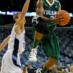 November 27, 2011; New Orleans, LA; Tulane Green Wave guard Ricky Tarrant (2) drives and shoots past San Diego Toreros guard Johnny Dee (1) during the first half of Hoops for Hope Classic at the New Orleans Arena. Tulane defeated San Diego 65-46. Mandatory Credit: Derick E. Hingle-US PRESSWIRE