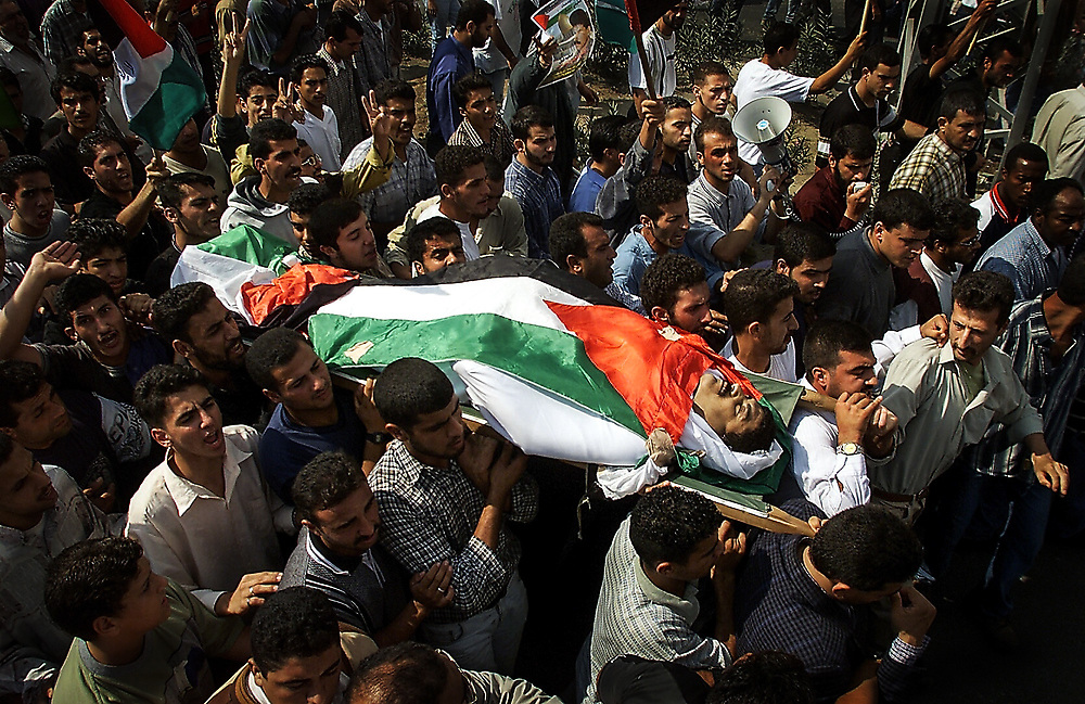 10/20/2000  --  Nablus, Israel  --   The funeral march of Palestinian businessman Zahy Fathy in the streets of Nablus, Israel on Friday, October 20, 2000. Fathy was killed in gun battle as was an Isreali soldier during fighting as Jewish settlers tried to visit Joseph's Tomb on Mount Ebal which was recently ransacked by Palestinians.  (Photo by Jack Gruber/USA Today)