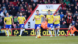 Huddersfield Town's Jacob Butterfield makes a break with the ball - Photo mandatory by-line: Paul Knight/JMP - Mobile: 07966 386802 - 14/02/2015 - SPORT - Football - Bournemouth - Goldsands Stadium - AFC Bournemouth v Huddersfield Town - Sky Bet Championship