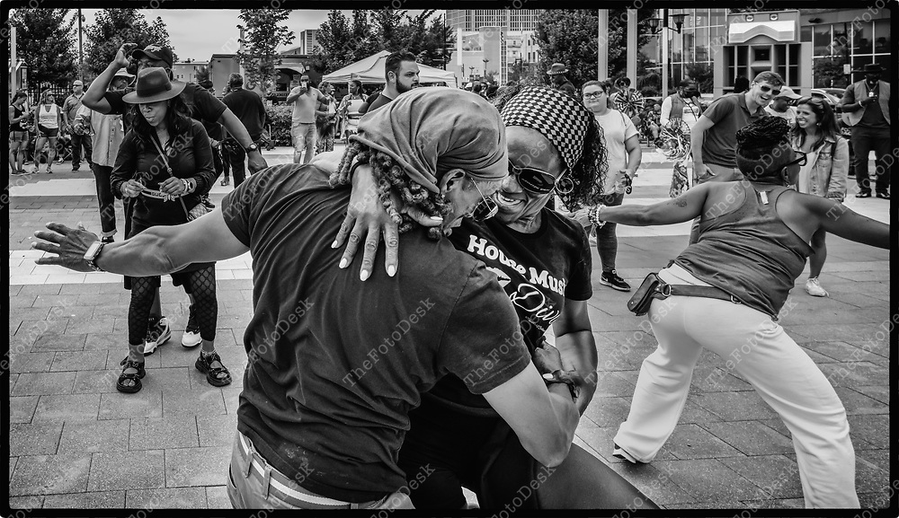NEWARK, NEW JERSEY: Monique Dujue, right dances with a partner during Bang The Drum House Music a day in the park at Mulberry Commons in in Newark, NJ on Sunday, August 29, 2021. (Brian B Price/TheFotodesk).