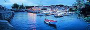 Photographic art panorama of fishing boats at evening in the harbor of Mundaka, Spain