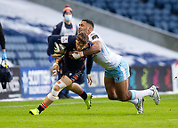 Rugby Union - 2020 / 2021 Guinness Pro-14 - Edinburgh vs Glasgow Warriors - Murrayfield<br /> <br /> Darcy Graham of Edinburgh Rugby is tackled by Ratu Tagive of Glasgow Warriors<br /> <br /> COLORSPORT/BRUCE WHITE