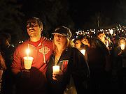 Oct 1, 2015 - Roseburg, Oregon, U.S. - <br /> <br /> Pastor Grant Goins and Rosemary Alwan sing along to 'Amazing Grace' during a candlelight vigil, held Thursday, October 1, 2015 in Roseburg, Oregon, for the victims of the mass shooting earlier in the day at UCC.<br /> ©Exclusivepix Media