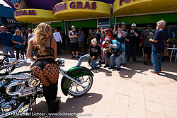 Models posing for photographer Chopper Dave Droege working the annual Boardwalk Bike Show during Daytona Bike Week. FL. USA. Friday March 16, 2018. Photography ©2018 Michael Lichter.