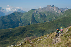 Mountain bikers riding on uphill, Zillertal, Tyrol, Austria