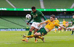 DUBLIN, REPUBLIC OF IRELAND - Sunday, October 11, 2020: Wales' Ben Davies (L) tackles Republic of Ireland's Cyrus Christie during the UEFA Nations League Group Stage League B Group 4 match between Republic of Ireland and Wales at the Aviva Stadium. The game ended in a 0-0 draw. (Pic by David Rawcliffe/Propaganda)