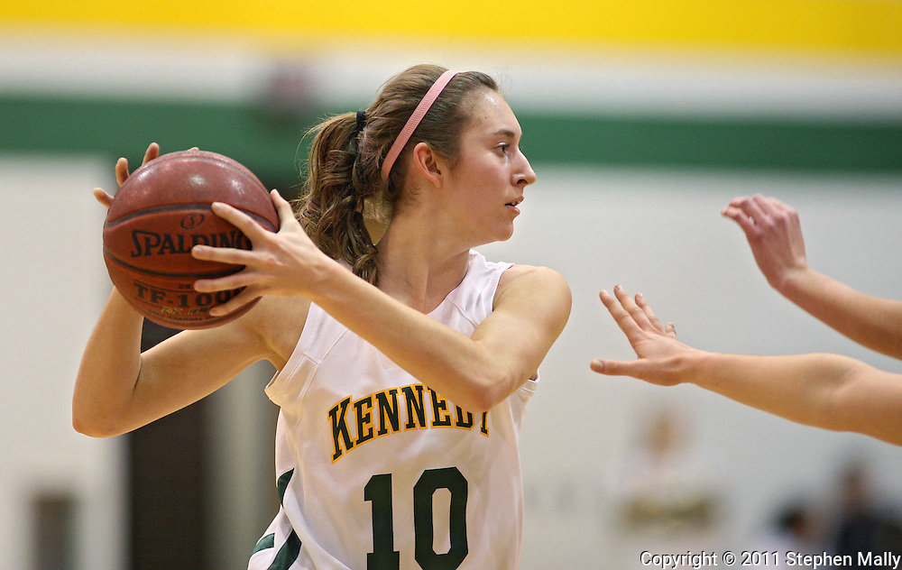 Kennedy's Courtney Strait (10) keeps the ball away from the defenders during their game at Kennedy High School, 4545 Wenig Rd NE in Cedar Rapids on Tuesday evening, February 8, 2011. Iowa City West defeated Cedar Rapids Kennedy 62-53. (Stephen Mally/Freelance)