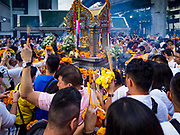 09 NOVEMBER 2017 - BANGKOK, THAILAND: People walk in a clockwise direction around the shrine during offerings at the Erawan Shrine on the 61st anniversary of the shrine's dedication. The Erawan Shrine is one of the most popular shrines in Bangkok. It was dedicated on November 9, 1956, after a series of construction accidents at what was then the Erawan Hotel (since torn down and replaced by the Grand Hyatt Erawan Hotel). The statue in the shrine is Phra Phrom, the Thai representation of the Hindu god of creation Brahma. It is a Hindu shrine popular with Thai and Chinese Buddhists because it is thought that making an offering to the Phra Phrom will bring good fortune.    PHOTO BY JACK KURTZ