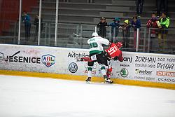 Miha ZAJC vs Tadej Cimzar during First league between HDD Acroni Jesenice vs HK SZ Olimpia, on April 23, 2019 in Jesenice, Slovenia. Photo by Peter Podobnik / Sportida