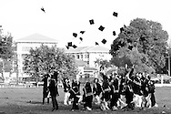 Elated students throw their graduation caps in the air for a photograph, Hanoi, Vietnam, Southeast Asia