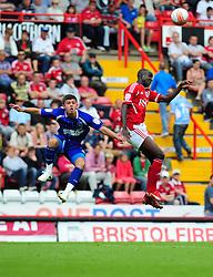 Bristol City's Albert Adomah battles for the high ball with Ipswich Town's Aaron Cresswell - Photo mandatory by-line: JMPUK - 06/08/2011 - SPORT - FOOTBALL - Championship - Bristol City v Ipswich Town - Ashton Gate Stadium, Bristol, England