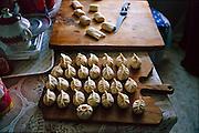 Regzen Batsuuri has prepared buuz (mutton-stuffed dumplings) with the help of his daughter, Khorloo. Hungry Planet: What the World Eats (p. 232).