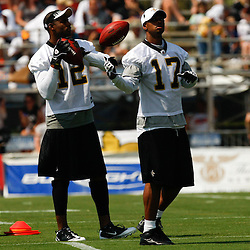 August 1, 2010; Metairie, LA, USA; New Orleans Saints wide receiver Marques Colston (12) and wide receiver Robert Meachem (17) during a training camp practice at the New Orleans Saints practice facility. Mandatory Credit: Derick E. Hingle