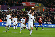 Ki Sung-Yueng of Swansea city © celebrates after he scores his teams 1st goal. Barclays Premier league match, Swansea city v West Bromwich Albion at the Liberty Stadium in Swansea, South Wales  on Boxing Day Saturday 26th December 2015.<br /> pic by  Andrew Orchard, Andrew Orchard sports photography.