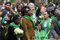 © Licensed to London News Pictures. 14/06/2019. London, UK. People wearing a symbolic green scarves take part in a ceremony to commemorate the second anniversary of the Grenfell Tower fire. On 14 June 2017, just before 1:00 am a fire broke out in the kitchen of the fourth floor flat at the 24-storey residential tower block in North Kensington, West London, which took the lives of 72 people. More than 70 others were injured and 223 people escaped. Photo credit: Dinendra Haria/LNP