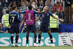 (L-R) Antoine Griezmann of France, Presnel Kimpembe of France, Kylian Mbappe of France during the 2018 FIFA World Cup Russia Final match between France and Croatia at the Luzhniki Stadium on July 15, 2018 in Moscow, Russia