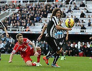 Alberto Moreno of Liverpool along with Fabrizo Coloccini of Newcastle United watch as his volley bounces out of play - Barclays Premier League - Newcastle Utd vs Liverpool - St James' Park Stadium - Newcastle Upon Tyne - England - 1st November 2014  - Picture Simon Bellis/Sportimage