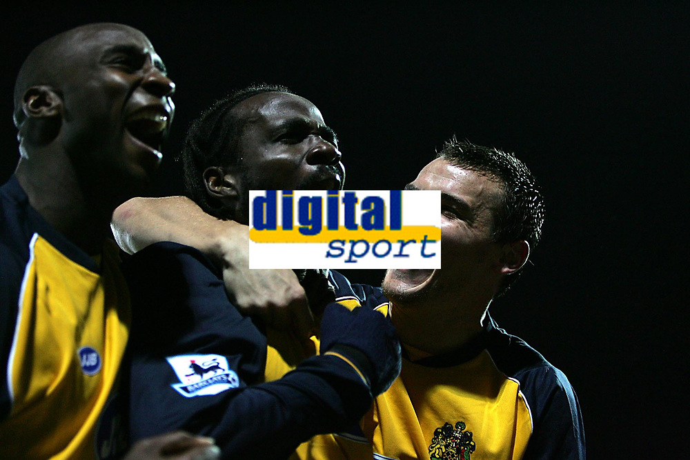 Photo: Lee Earle.<br /> Portsmouth v Wigan Athletic. The Barclays Premiership. 05/11/2005. Wigan's Pascal Chimbonda (C) is congratulated by Jason Roberts (L) and Lee McCulloch (R) after scoring the opening goal.
