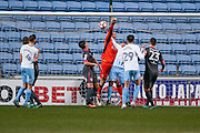 Morecambe  goalkeeper Barry Roche (1) misses his punch during the The FA Cup match between Coventry City and Morecambe at the Ricoh Arena, Coventry, England on 15 November 2016. Photo by Simon Davies.
