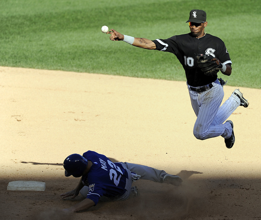 CHICAGO - SEPTEMBER 12:  Alexei Ramirez #10 of the Chicago White Sox throws the ball after making a force play on Lucas May #22 of the Kansas City Royals on September 12, 2010 at U.S. Cellular Field in Chicago, Illinois.  The White Sox defeated the Royals 12-6.  (Photo by Ron Vesely)
