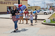 A group from Ascension Parish come to a makeshift memorial for fallen officers  in front of the B-quick store on Airline in Baton Rouge where officers were killed on Sunday.