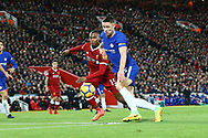 Gary Cahill of Chelsea (r) looks to get a shot away under pressure from Daniel Sturridge of Liverpool. Premier League match, Liverpool v Chelsea at the Anfield stadium in Liverpool, Merseyside on Saturday 25th November 2017.<br /> pic by Chris Stading, Andrew Orchard sports photography.