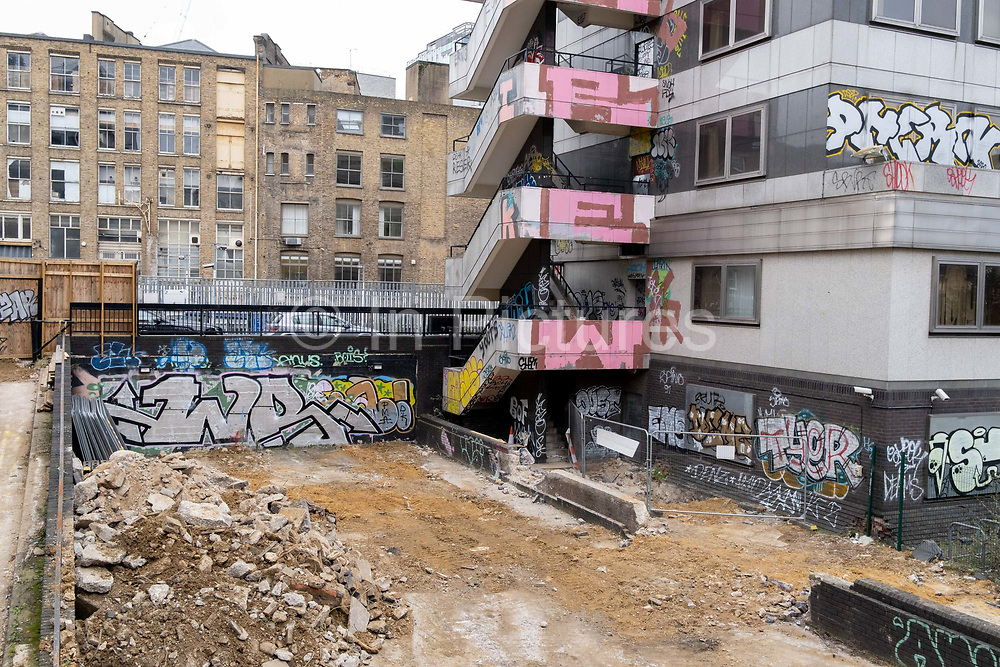 A leftover from the historical period in Londons wartime past, is a former WW2 bomb site that is still largely derelict in a deserted city between Paul and Kiffen Streets, on 11th January 2021, in the City of London, England.