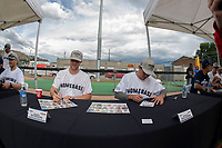 KELOWNA, CANADA - JUNE 28: Former Kelowna Rocket and current NHL New Jersey Devils player Damon Severson and Montreal Canadiens player Brendan Gallagher sign autographs prior to the opening charity game of the Home Base Slo-Pitch Tournament fundraiser for the Kelowna General Hospital Foundation JoeAnna's House on June 28, 2019 at Elk's Stadium in Kelowna, British Columbia, Canada.  (Photo by Marissa Baecker/Shoot the Breeze)