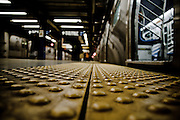 On the edge of the line at Canal street station, Manhattan, New York, 2009.