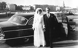 Before rising to power as one of the most infamous leaders in the world, Putin was a playful, hipster-dressing man in love. July 28, 1983 - Russia - The bride and groom right after their wedding, getting ready to drive off for their honeymoon. Groom VLADIMIR VLADIMIROVICH PUTIN, 30, (born October 7, 1952 in Leningrad, Russian SFSR, Soviet Union, now Saint Petersburg) and his bride LYUDMILA ALEKSANDROVNA SHKREBNEVA, 25, (born January 6, 1958), on their wedding day in 1983. (Credit Image: © Russian Archives via ZUMA Wire)