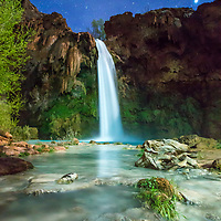 Happened to have a hiker walk up while taking long exposures of Havasu Falls under a partial moon.  Some quick adjustments to my camera settings and I was able to capture this image while my new friend painted the area with his headlamp while he looked around. © John McBrayer